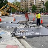 Hammering asphalt for trench between DDOT MH-B & DDOT MH-I.