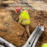 Hammering PEPCO MH-*J box at conduit trench from TC. (Columbia & Harvard island)