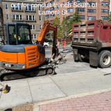 Hammering pavement and haulingout for conduit trench South of Lamont St.