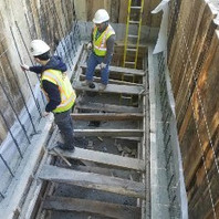 Contractor continued cast-in-place manhole wall and formed the rebar.