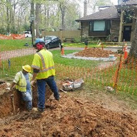 Contractor excavated trench for 37-LF of 1-inch copper service line connection to house #6300.