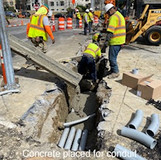 Concrete placed for conduit between DDOT MH-C & DDOT MH-B.