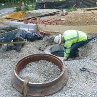 Contractor adjusted sewer manhole top MH8-1.