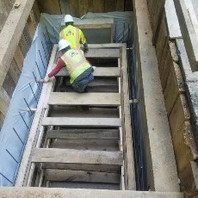 Contractor continued to construct within Shore Box, the castin place Manhole MH21.