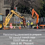 Hammering pavement to prepare conduit trench near DDOT MH-A at 16th Mt. Pleasant.