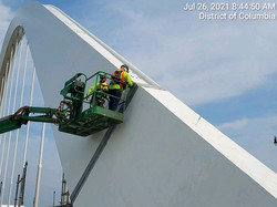 Applying touch-up paint on the Span 3 north steel arch.