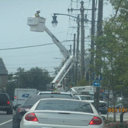 Installing mast arms and light fixtures on wood poles from Cypress Sr, SE to Raleigh St, SE.