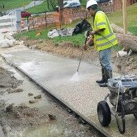 Contractor power washed previously placed Exposed Aggregate Sidewalk along Oregon Avenue on Phase 2.
