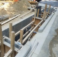 Contractor excavated, prepared, formed, and poured PCC Check Dam within LID9-1.