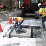 Installed manhole at Harvard St. & Mt. Pleasant St. NW.