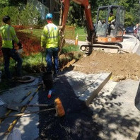 Contractor excavated for the exposed water main in preparation for tie-in on Bingham.