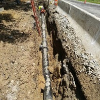 Contractor trench excavated for the installation of Ductile Iron Water pipe and backfilled.