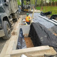 Contractor formed and poured concrete check dam on LID 10-3.