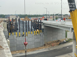 Erecting and backfilling MSE Wall panels at Abutment B.