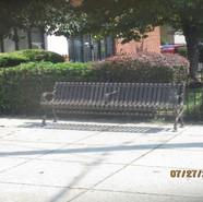 Installing bench at SB MLK before 5th St, SE at Church.