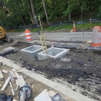 Contractor backfilled cast-in-place manhole MH26 after placing concrete.