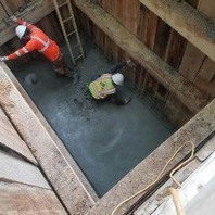 Contractor prepared the bottom of the manhole M19 and poured concrete.