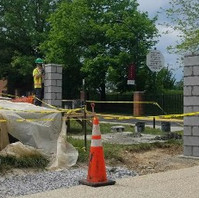 Contractor continued to install brick column and ornamental fence installation.