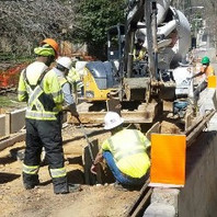 Contractor excavated trench for DCPLUG work and installed fiber glass and PVC conduit.