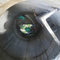 Contractor within manhole MH51 placed mortar and brick for channel lining.