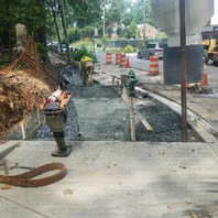 Contractor excavated, formed, and placed concrete for exposed aggregate sidewalk.