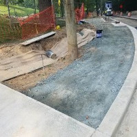 Contractor prepared base with GAB for exposed aggregate side-walk pavement.