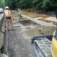 Contractor continued with manhole cover adjustment.