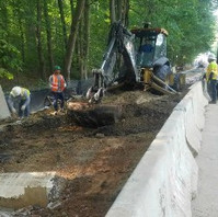 Contractor performing roadway full excavation into the subgrade.