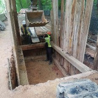 Contractor installed timber shoring while excavating for the DC-PLUG manhole MH19.