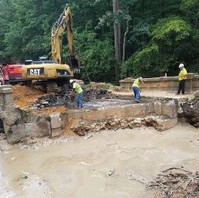 Contractor excavating the south end of the Bridge abutment to be ready for caisson drilling foundation for Bridge.