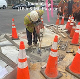 Placing grounding rod into pole foundation. (16th & Mt. Pleasant)