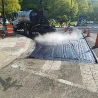 Contractor prepared roadway to receive final asphalt.