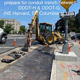 Hammering pavement to prepare for conduit trench between DDOT-H & DDOT-G (NE Harvard, SE Columbia at 16th)