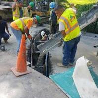 "Contractor installing DC Plug FRE 5""-2W and 5""-6W at Nebraska Avenue encased in concrete."