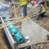 Contractor Installing DC Water 21-inch PVC Pipe Type - 1.