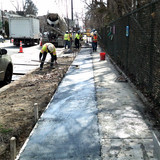 Placed concrete side walk at 16th NW & Spring Rd.