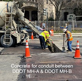 Concrete for conduit between DDOT MH-A & DDOT MH-B.
