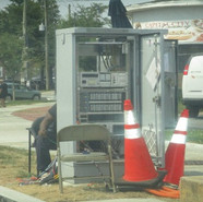 DDOT Traffic inspector checking on traffic signal cabinet on SB MLK between Parkland St, SE and Raleigh St, SE.