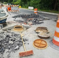 Contractor reset Manhole frame and covers at several locations.
