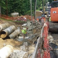 Contractor drilling excavation for caisson foundation for retaining wall #3 and placed concrete.