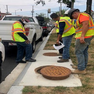 DC water inspecting catch basins throughout the project.