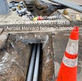 Conduit between DDOT MH-A & DDOT MH-B. (Across Harvard between islands)