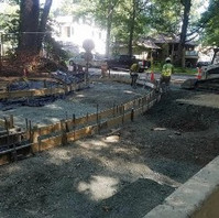 Contractor formed for PCC Curb and Gutter and Wheelchair ramp and placed concrete.