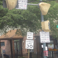 Installing traffic sign on the overhead mast arm at NB MLK & EB Lebaum St, SE intersection.