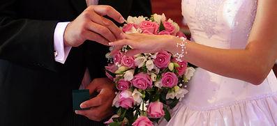 Bride & Groom Exchanging Rings Photo