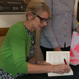 Children's Laureate Lauren Child signing books after her show at Jersey Opera House