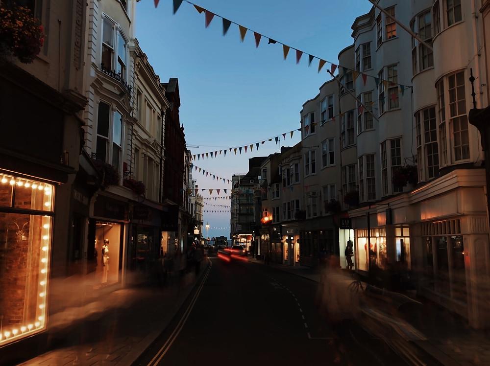 A Brighton street a night, bunting.