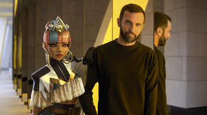 Nicolas Ghesquiere, current creative director of Louis Vuitton, stands next to video game character Qiyana from League of Legends.