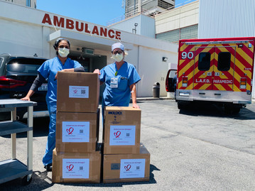 Medical workers with boxes of PPE