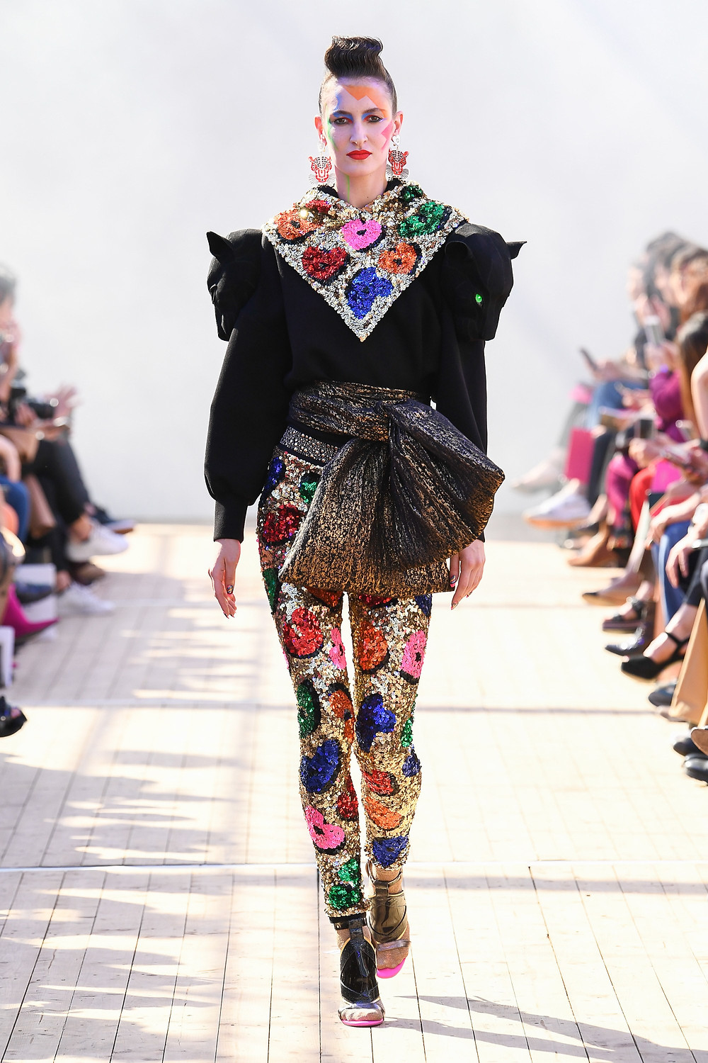 Model wearing Manish Arora fashion designs.